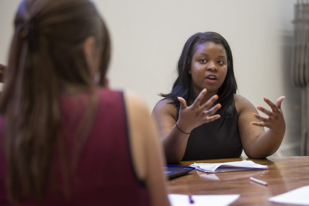 Women, especially black and Latina women, in Greater Boston make less than men. Here, Kristina Desir, a program manager for the American Association of University Women (AAUW), leads a salary negotiation workshop in Dorchester. (Jesse Costa/WBUR/file)
