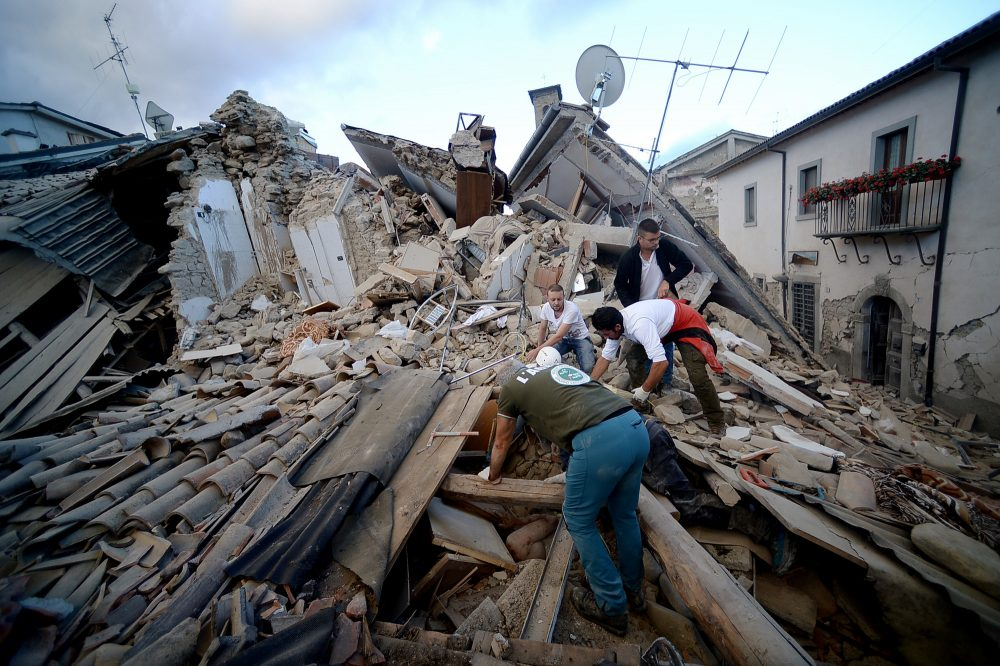 A resident searches for victims in the rubble after a strong earthquake hit Amatrice on Aug. 24, 2016. (Flippo Monteforte/AFP/Getty Images)