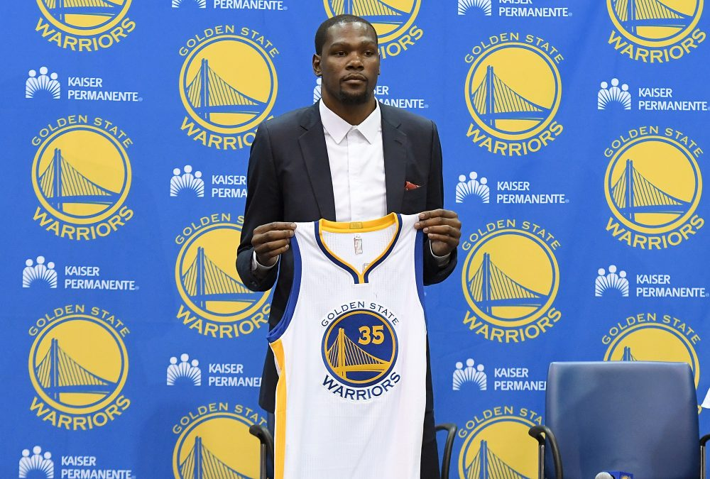 Kevin Durant's decision to join the Warriors made him Public Enemy No. 1 in the eyes of many Thunder fans. One fan is using that decision to inspire his students. (Thearon W. Henderson/Getty Images)