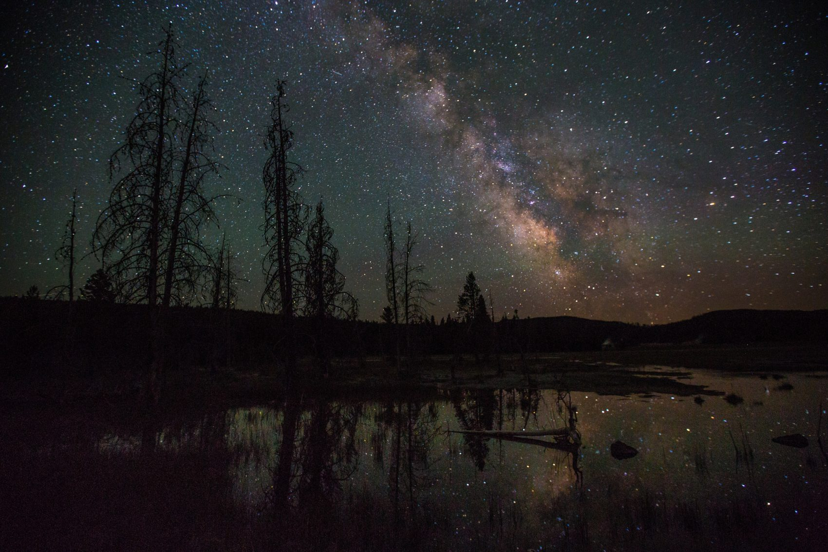 The Milky Way over Firehole Lake Drive in Yellowstone National Park. (Neal Herbert/National Park Service via Flickr)