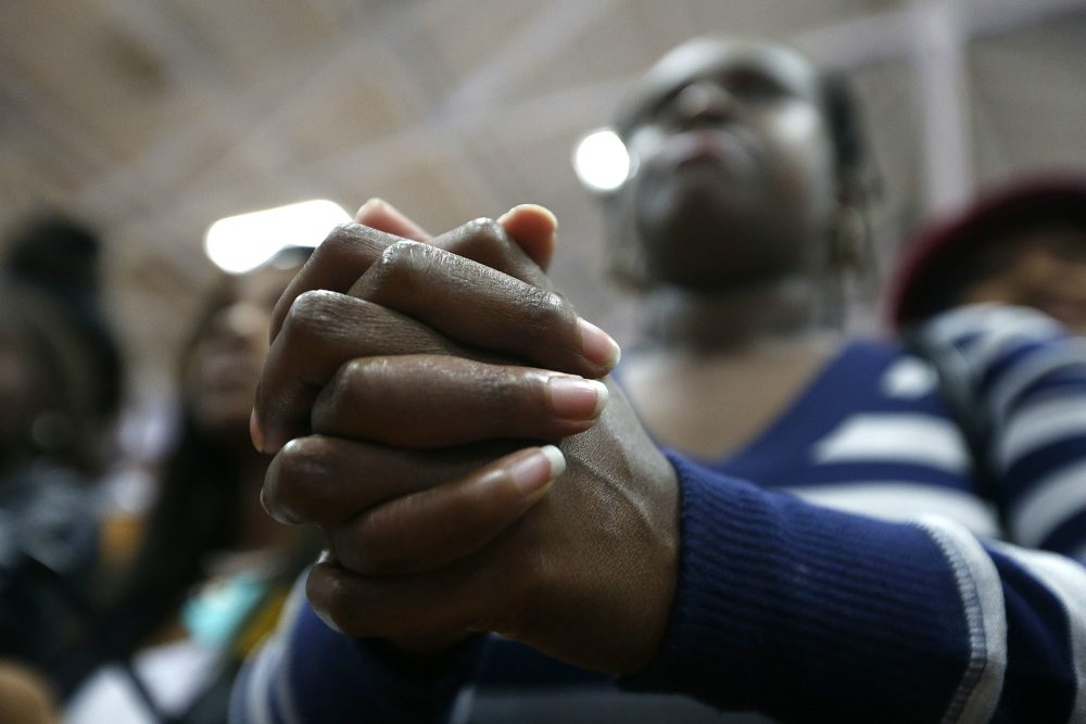"An audience member clasps her hands as she listens to Democratic presidential candidate Hillary Clinton speak at a ""Get Out The Vote"" rally for historically black colleges and universities, at South Carolina State University in Orangeburg, S.C. on Feb. 26, 2016. (Gerald Herbert/AP)"