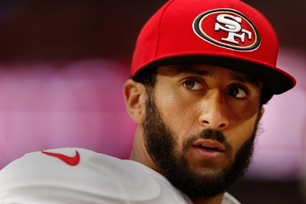 Colin Kaepernick, former quarterback of the San Francisco 49ers, watches from the sidelines during an NFL game against the Arizona Cardinals on Sept. 27, 2015 in Glendale, Arizona. (Christian Petersen/Getty Images)