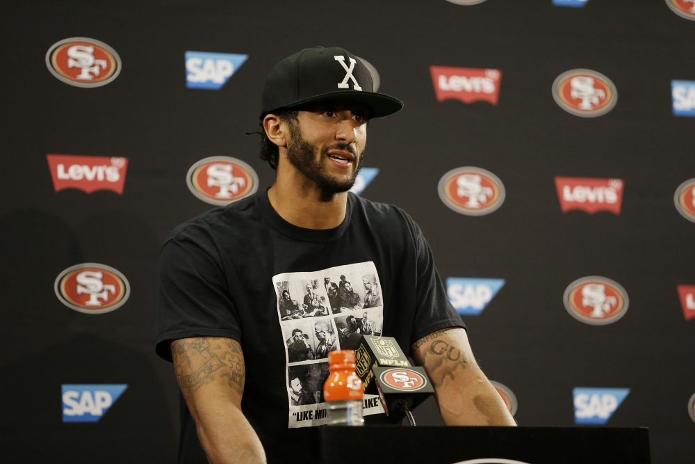 Colin Kaepernick has drawn criticism for sitting during the national anthem. (Ben Margot/AP)