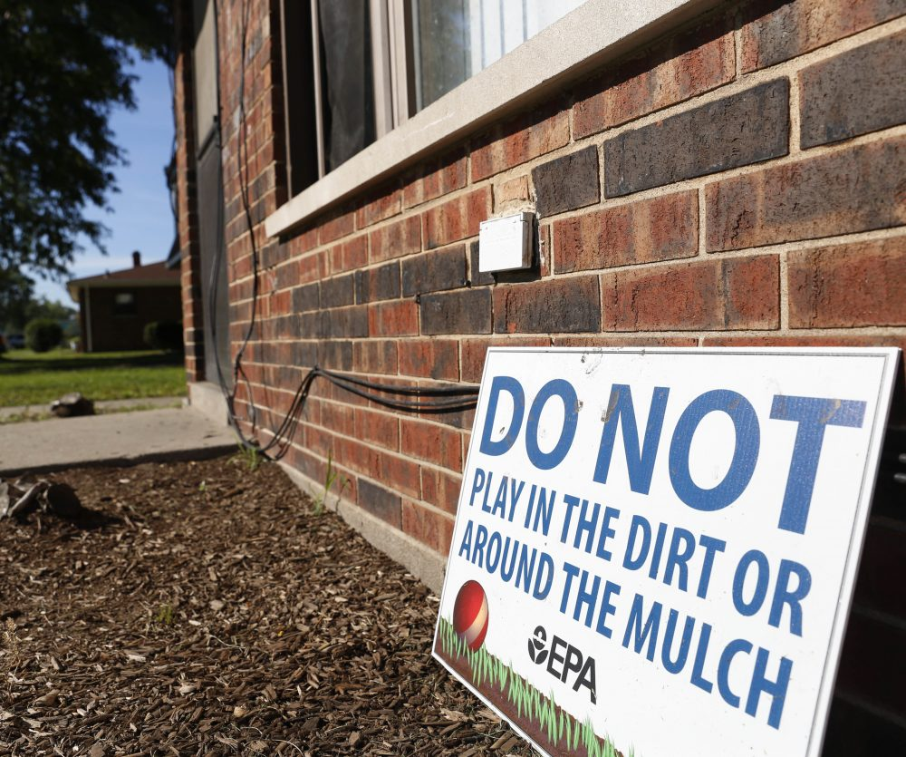 In this Aug. 23, 2016 photo, a sign from the Environmental Protection Agency is posted in front of West Calumet Housing Complex houses at East Chicago, Ind. The EPA has detected high levels of lead in samples of dust and dirt tracked inside homes where soil is tainted with industrial contaminants. (Tae-Gyun Kim/AP)