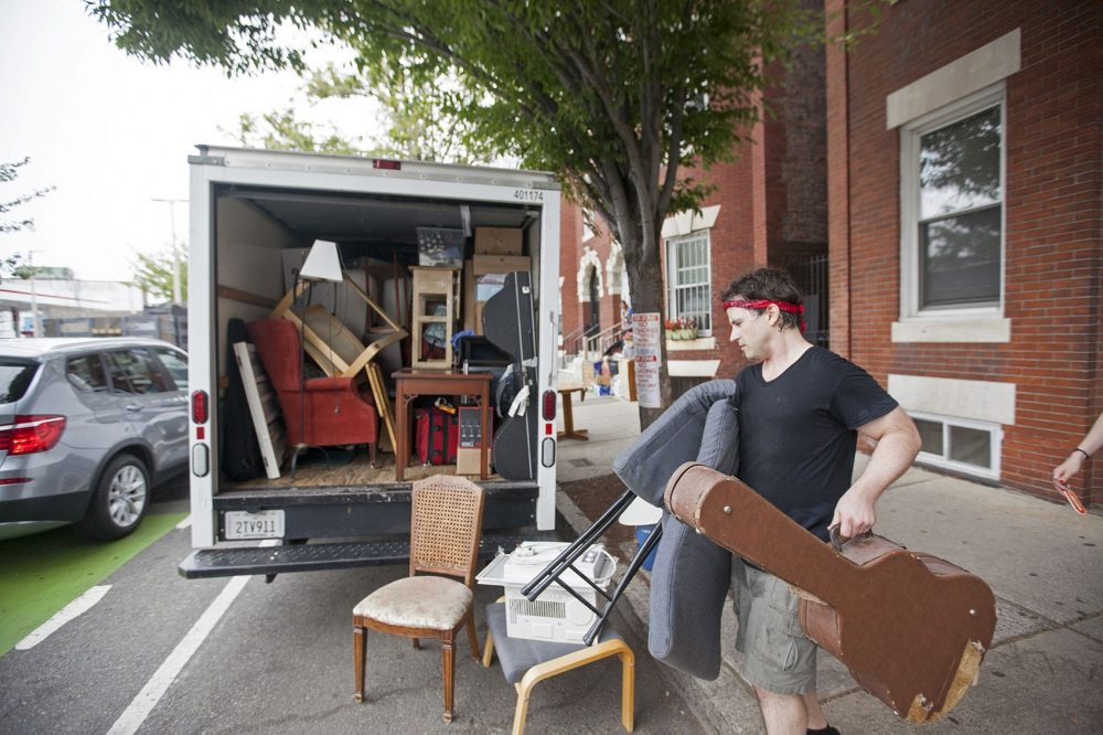 Noah Druckenbrod moves out of his Allston apartment on Wednesday, Aug. 31. (Joe Difazio for WBUR)