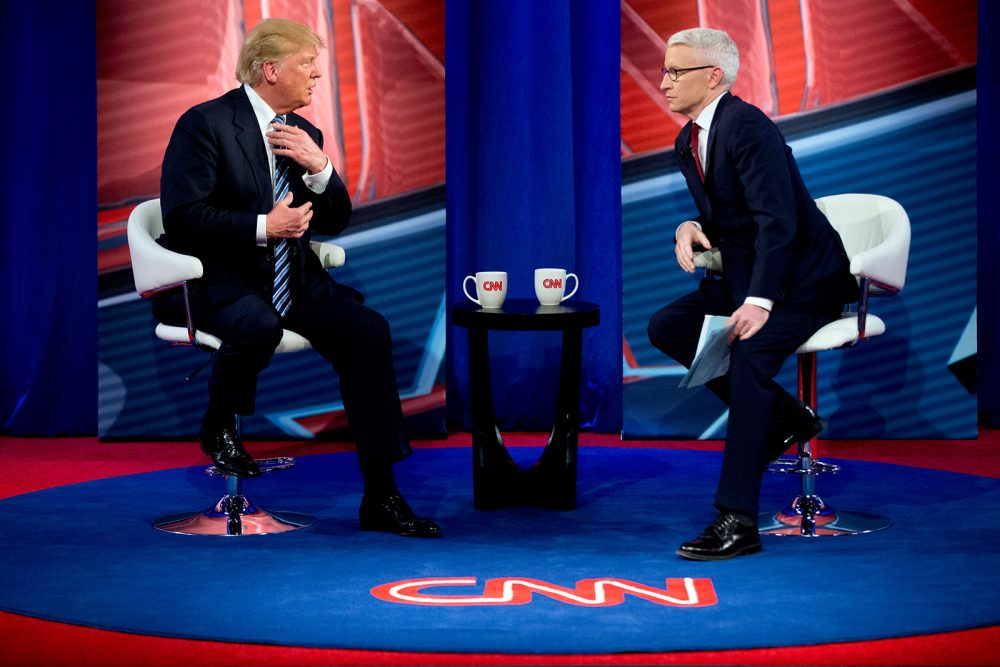 In this Feb. 18 file photo, Republican presidential candidate Donald Trump speaks with Anderson Cooper, right, during a commercial break at a CNN town hall. (Andrew Harnik/AP)