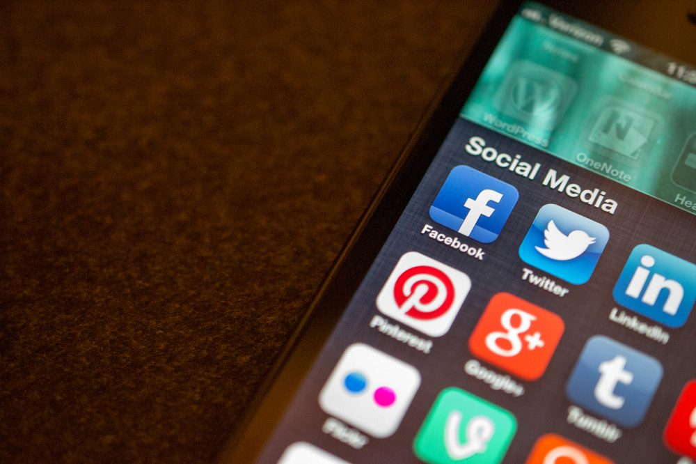 A phone full of social media apps. (Jason Howie/Flickr)
