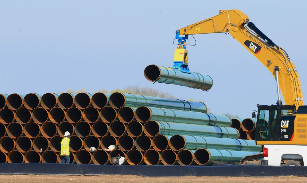 The Supreme Judicial Court on Wednesday did what the state Legislature would not, striking down a Baker administration push to facilitate the construction of new natural gas pipeline capacity in the state by allowing utilities pass the cost of pipeline construction on to ratepayers. In this 2016 file photo, pipes for a proposed pipeline in South Dakota are stacked at a staging area. (Nati Harnik/AP)