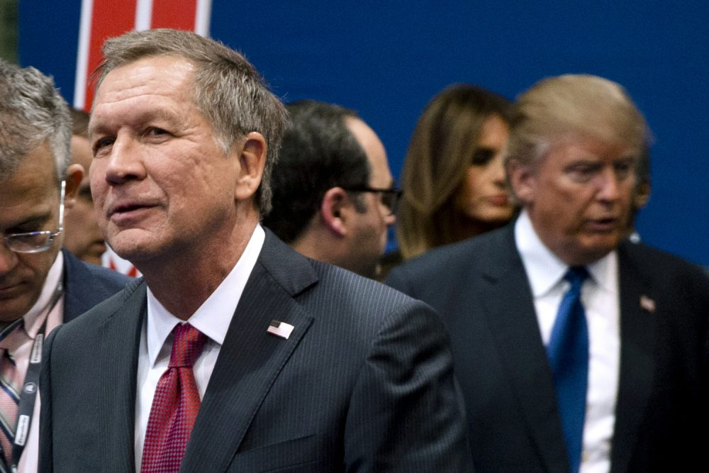 In this Feb. 6 file photo, Ohio Gov. John Kasich, left, and Donald Trump, right, speak to reporters after a Republican presidential primary debate at Saint Anselm College in Manchester, N.H. (/Matt Rourke/AP)