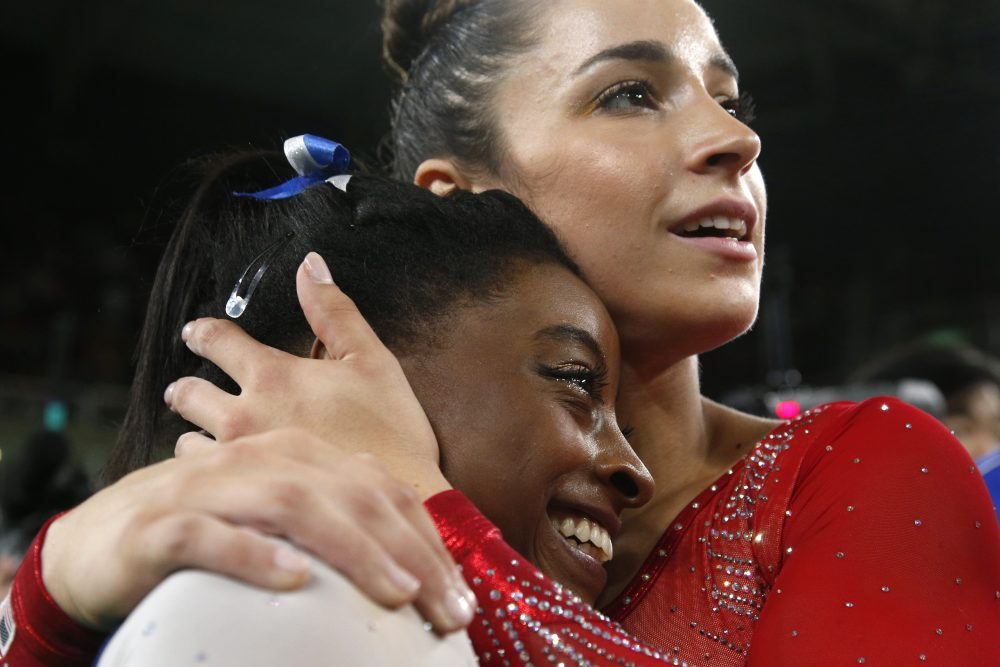 United States' Aly Raisman embraces compatriot Simone Biles after they won silver and gold respectively for the gymnastics women's individual all-around final at the 2016 Summer Olympics in Rio de Janeiro, Brazil, Thursday, Aug. 11, 2016. (Dmitri Lovetsky/AP)