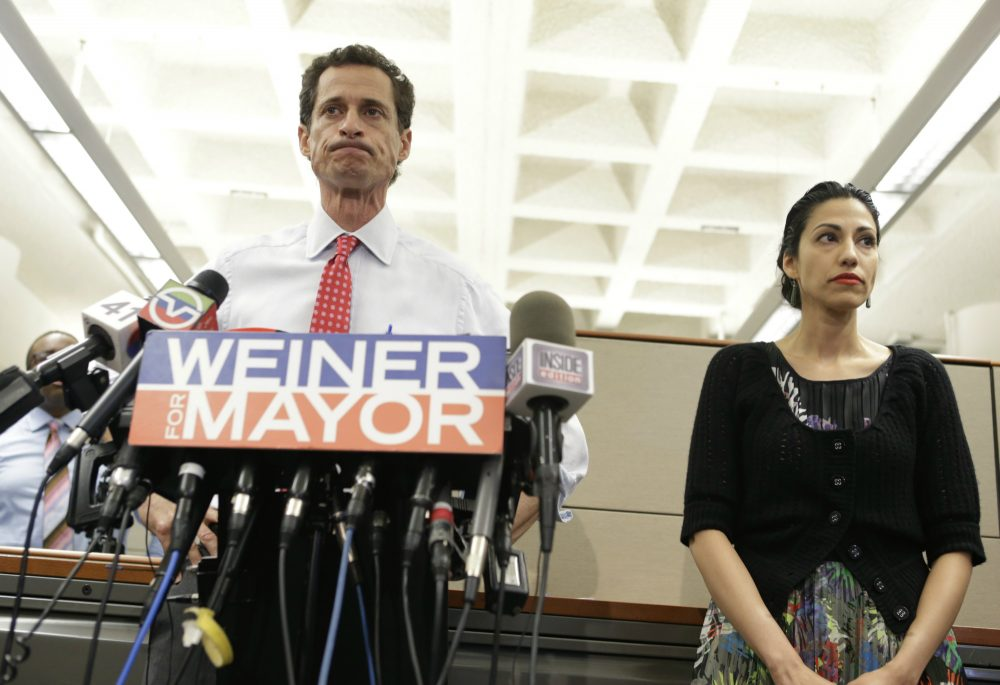 Anthony Weiner stands beside his wife Huma Abedin as he addresses the press about allegations of sexual text messages on July 23, 2013, in New York. (Kathy Willens/AP)