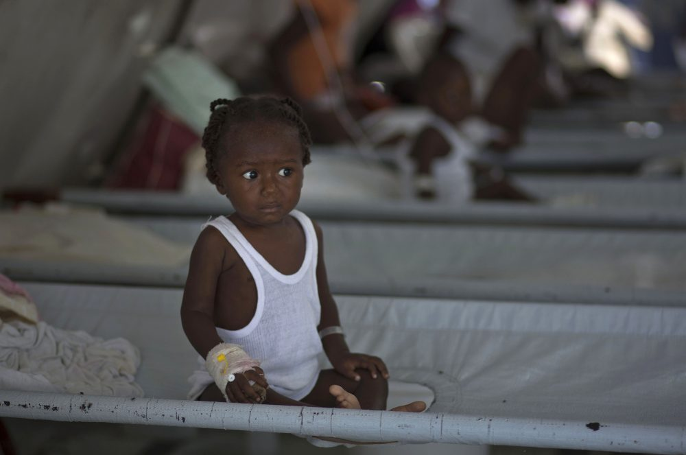In this Oct. 19, 2011, file photo, a girl receives treatment for cholera symptoms at a Doctors Without Borders cholera clinic in Port-au-Prince, Haiti. A U.S. federal appeals court has upheld the United Nations' immunity from a damage claim filed on behalf of 5,000 cholera victims who blame the U.N. for an epidemic of the deadly disease in Haiti. (AP Photo/Ramon Espinosa)