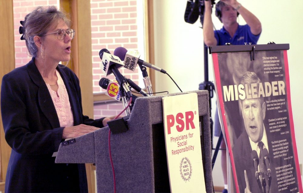 Maureen McCue, co-coordinator of the Iowa chapter of Physicians for Social Responsibility, speaks during a 2003 news conference in Des Moines, saying that President Bush hadn't been honest with the American people in his justification for attacking Iraq. (Steve Pope/AP)