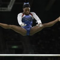 United States' Simone Biles performs on the uneven bars during the artistic gymnastics women's individual all-around final at the 2016 Summer Olympics in Rio de Janeiro, Brazil. (Dmitri Lovetsky/AP)
