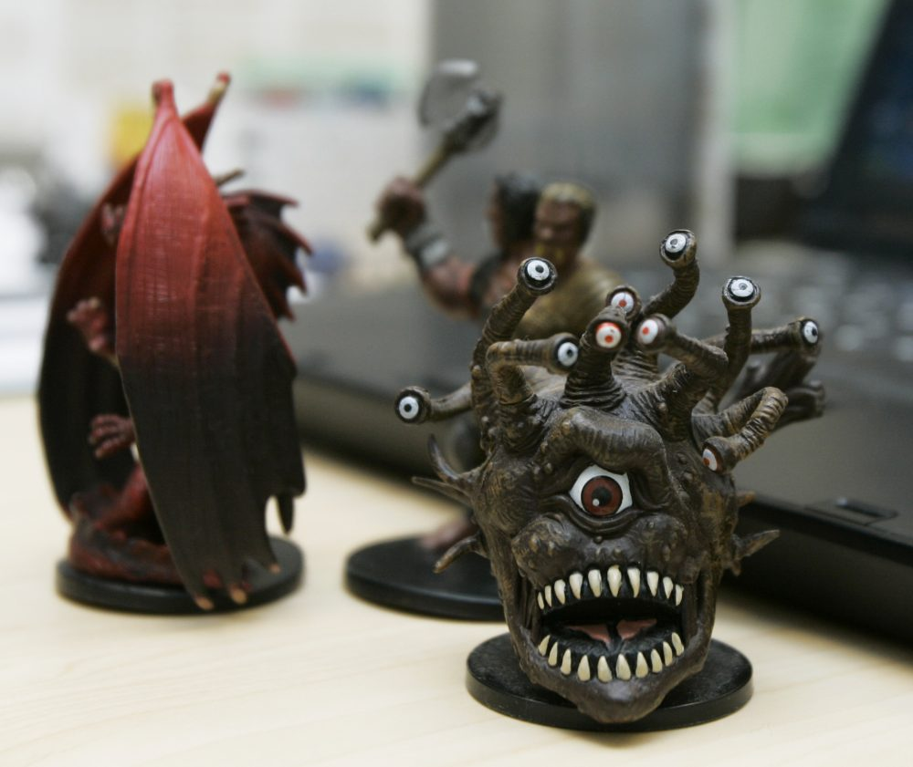 Miniature figures used in the Dungeons and Dragons roleplaying game. Pop culture writer Ethan Gilsdorf says that the plot line in the new 'Stranger Things' Netflix series takes inspiration from the board game, (Ted S. Warren/AP)