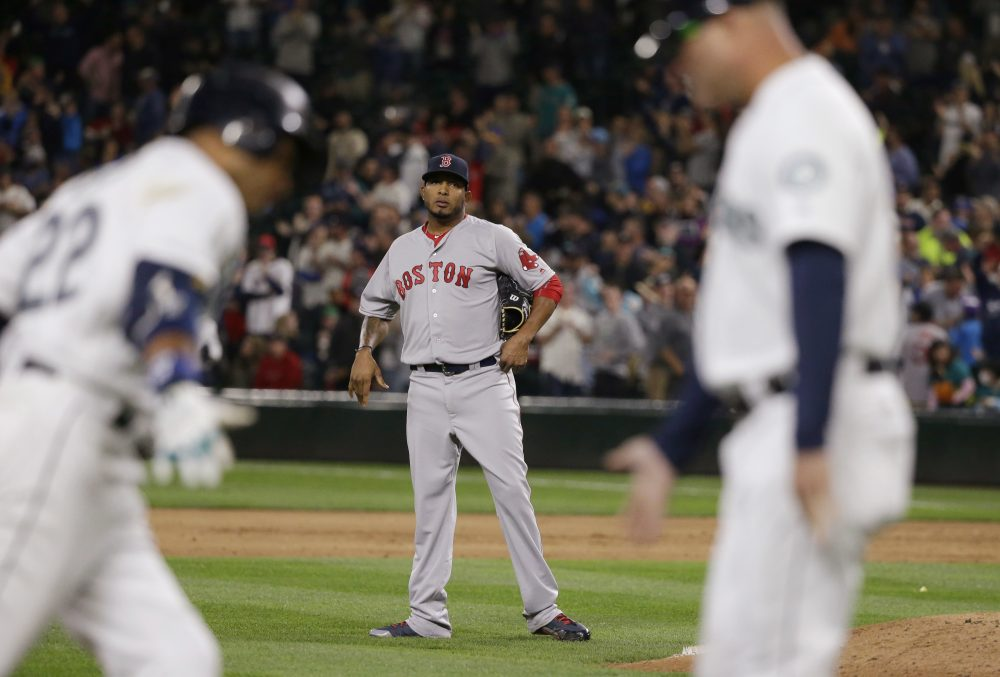 Boston Red Sox pitcher Fernando Abad watches as Seattle Mariners' Robinson Cano after Cano hit a a three-run home run during the eighth inning of the Red Sox vs. Mariners game Tuesday night. The Mariners defeated the Red Sox 5-4. (Ted S. Warren/AP)
