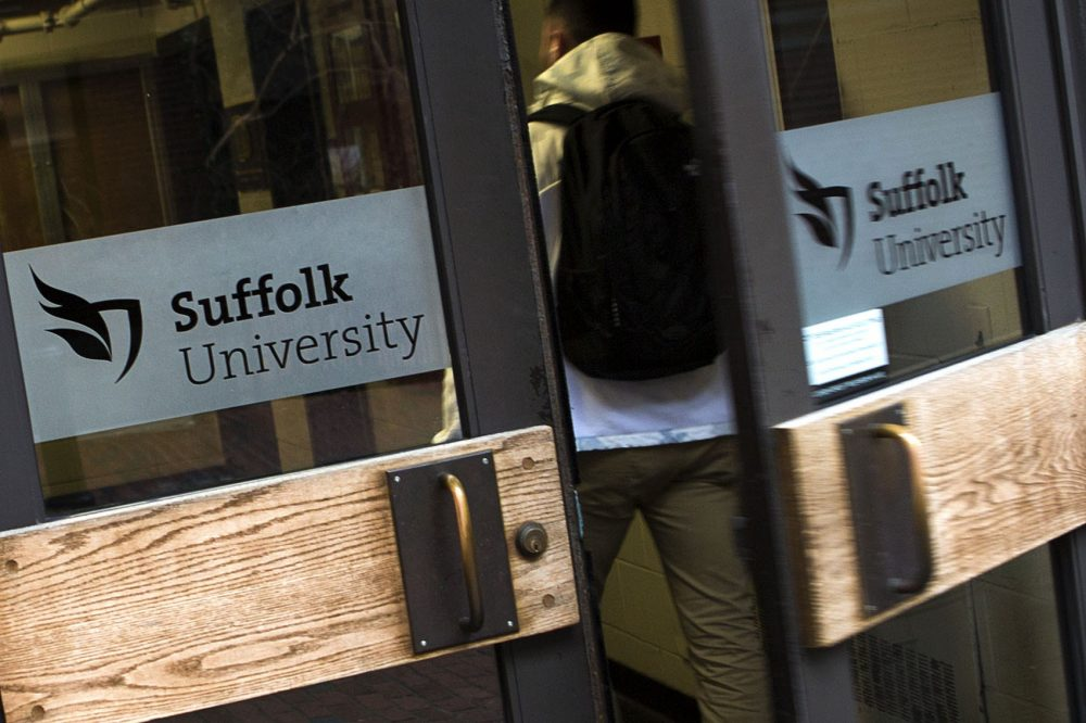 After the firing of Suffolk President Margaret McKenna in late July, what will be the future of the university? Pictured here: a student enters the Donahue Building at Suffolk University. (Jesse Costa/WBUR)