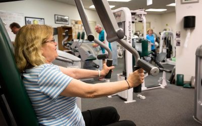 Anne Reel, 61, works out at the Quincy College gym on a busy weekday morning. (Robin Lubbock/WBUR)