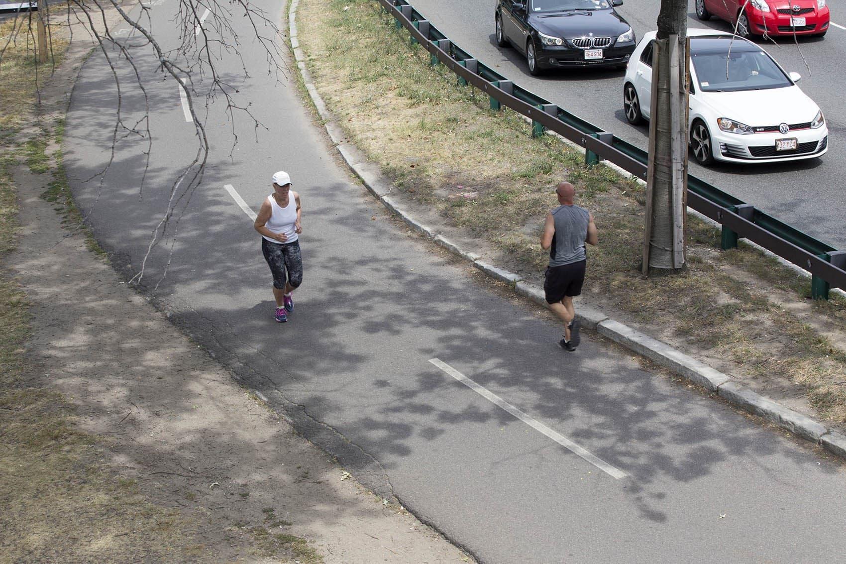 People run along on the Esplanade in Boston. (Joe Difazio for WBUR)