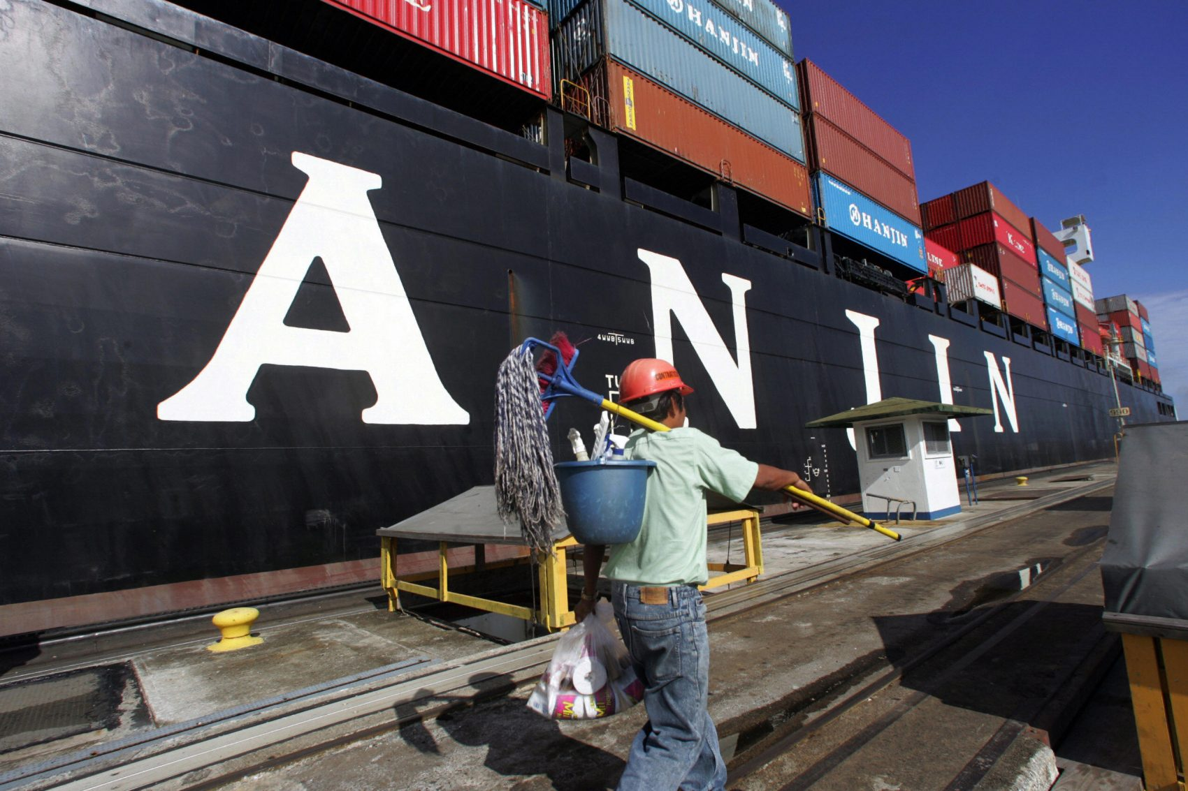 A worker walks next to a Hanjin cargo ship anchored in the Atlantic gate of the Panama Canal on Oct. 20, 2006. (Orlando Sierra/AFP/Getty Images)