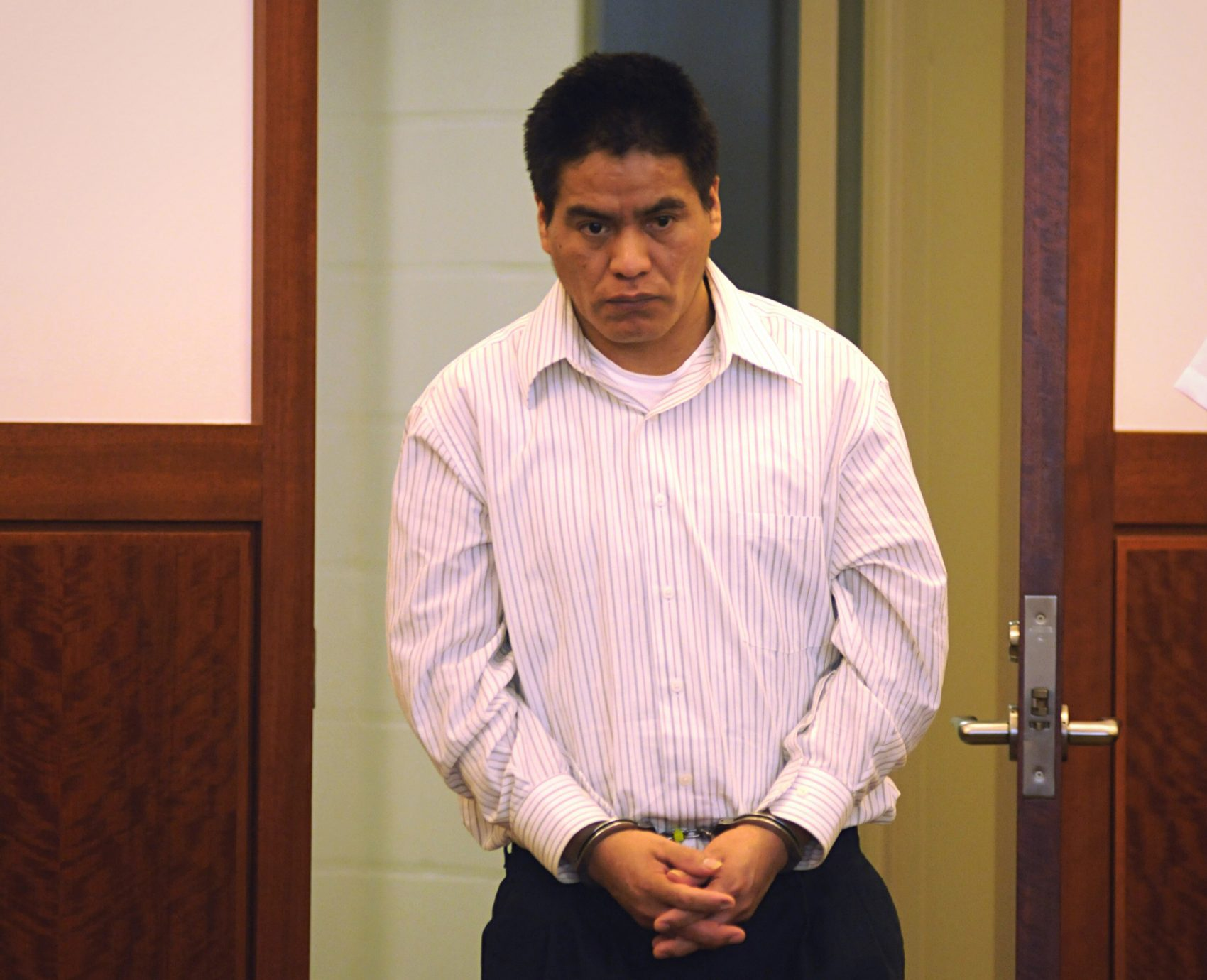 Nicholas Dutan Guaman, 37, of Ecuador, walks into Worcester Superior Court in 2014, where he was sentenced to up to 14 years in prison for dragging a Milford motorcyclist -- 23-year-old Matthew Denice -- to his death under his pickup truck. (The Telegram & Gazette, Rick Cinclair/AP)