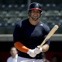 After a short career in the NFL, Tim Tebow is giving baseball a shot -- a sport he hasn't played regularly since high school. (Chris Carlson/AP)