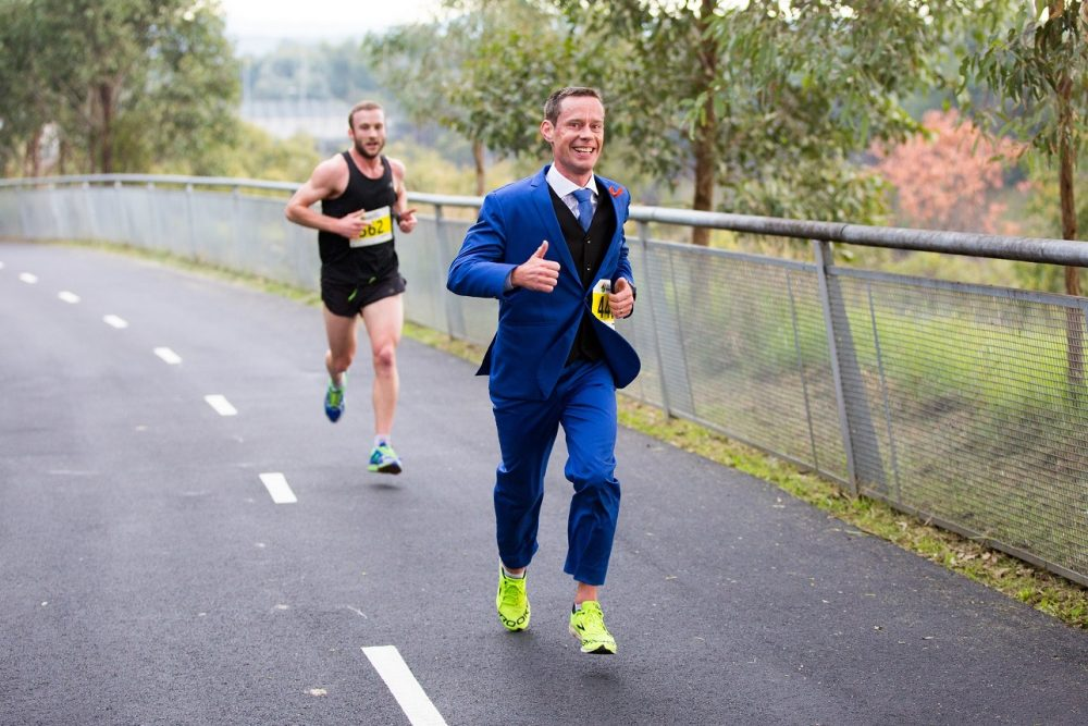 For Mike Tozer, running (in a suit) has become a way to cope with a difficult diagnosis. (Courtesy of Mike Tozer)