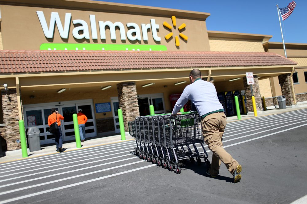 Wal-Mart employee Yurdin Velazquez pushes grocery carts at a Walmart store on Feb. 19, 2015 in Miami. (Joe Raedle/Getty Images)