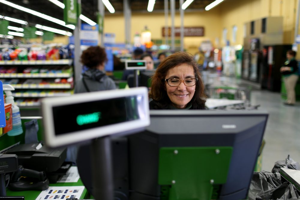 Wal-Mart employee Blanca Mojita rings up a customer's purchases at a Wal-Mart store on Feb. 19, 2015 in Miami. (Joe Raedle/Getty Images)