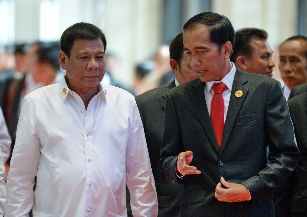 Philippine President Rodrigo Duterte (left) listens to Indonesia's President Joko Widodo while heading for a plenary session during the Association of Southeast Asian Nations (ASEAN) Summit in Vientiane on Sept. 6, 2016. (Roslan Rahman/AFP/Getty Images)