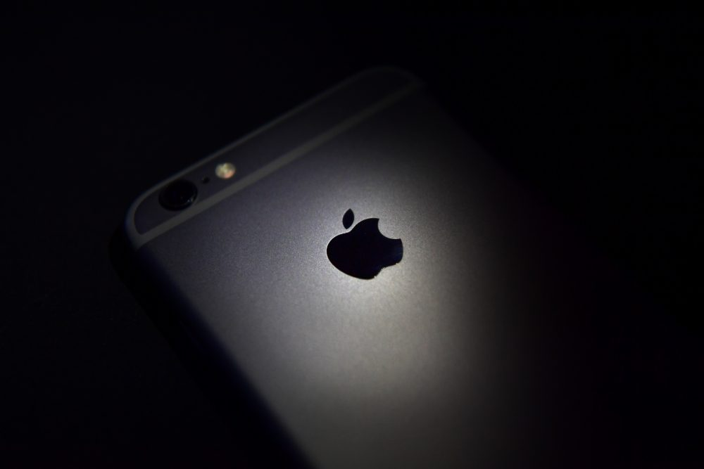The Apple logo displayed on the back of an iPhone. (Carl Court/Getty Images)