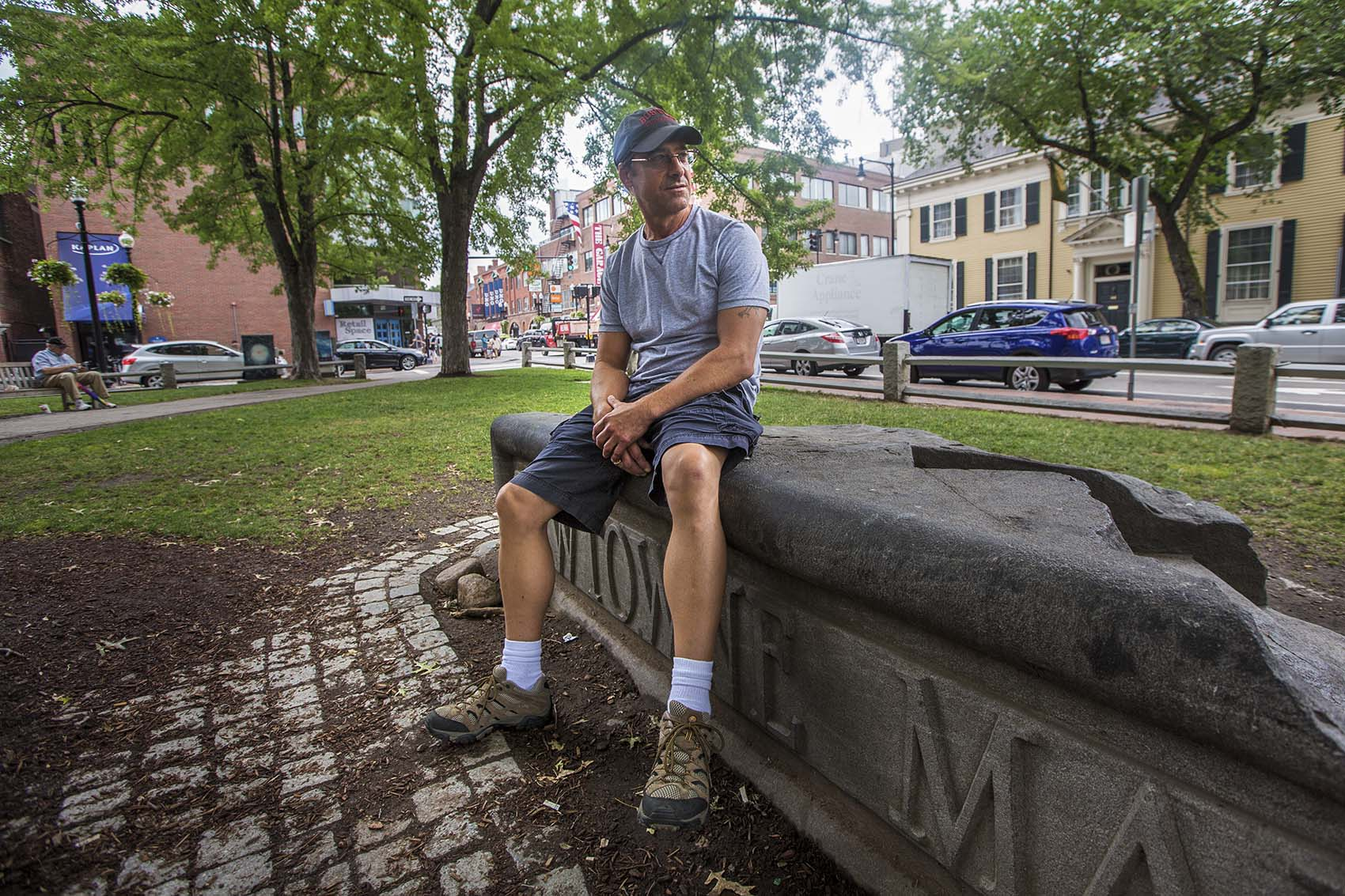 Greg Diatchenko, now 52, sits in Winthrop Square Park in Harvard Square. When he was 17, Diatchenko was sent to prison for life for fatally stabbing a 55-year-old. (Jesse Costa/WBUR)