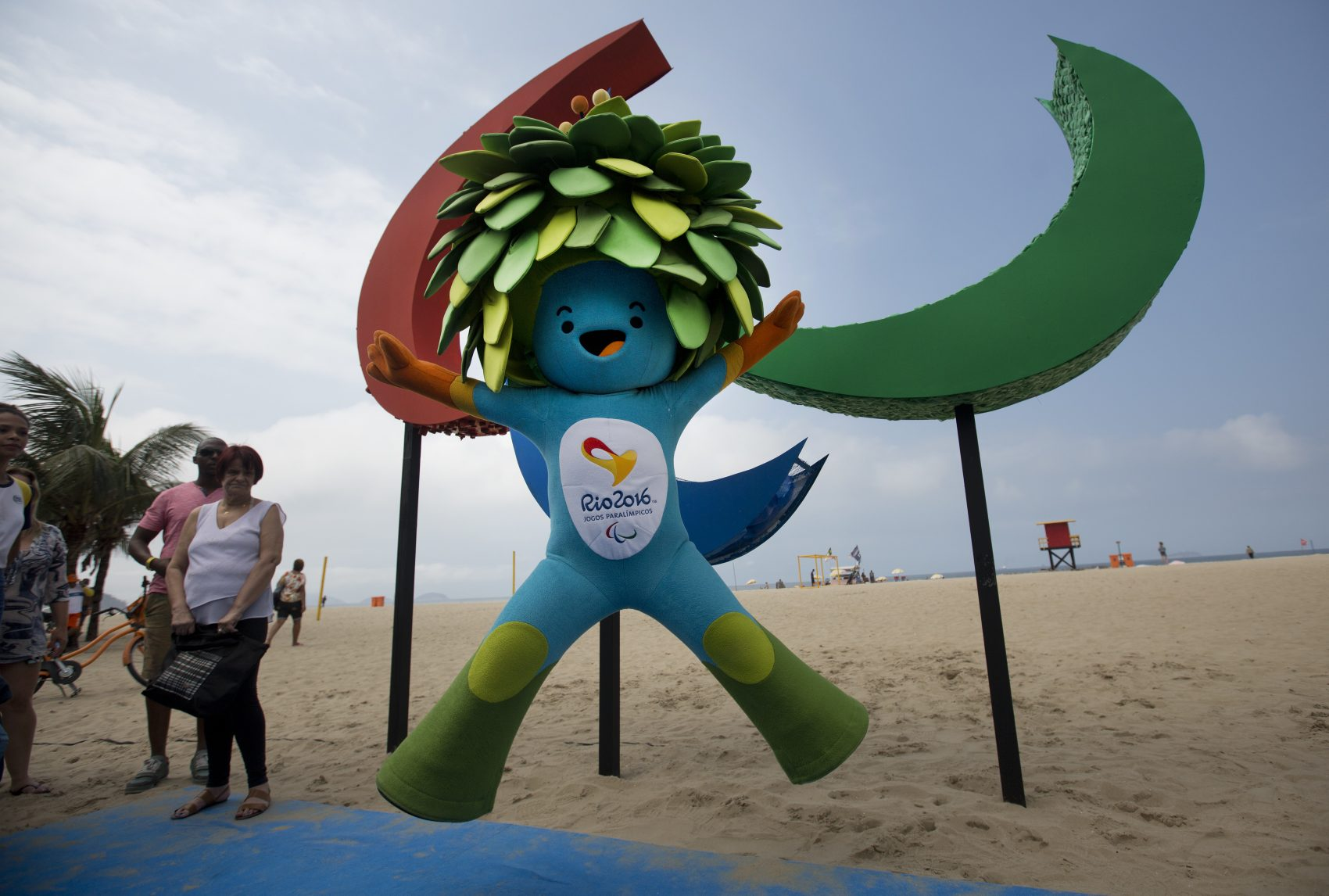 Tom, the mascot of the Rio Paralympics Games, jumps in front of the sculpture of Agitos, symbol of the Paralympic Games, on Copacabana beach in Rio de Janeiro. (Silvia Izquierdo/AP)