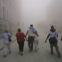 Civilians flee as a tower of the World Trade Center collapses Sept. 11, 2001. (Mario Tama/Getty Images)