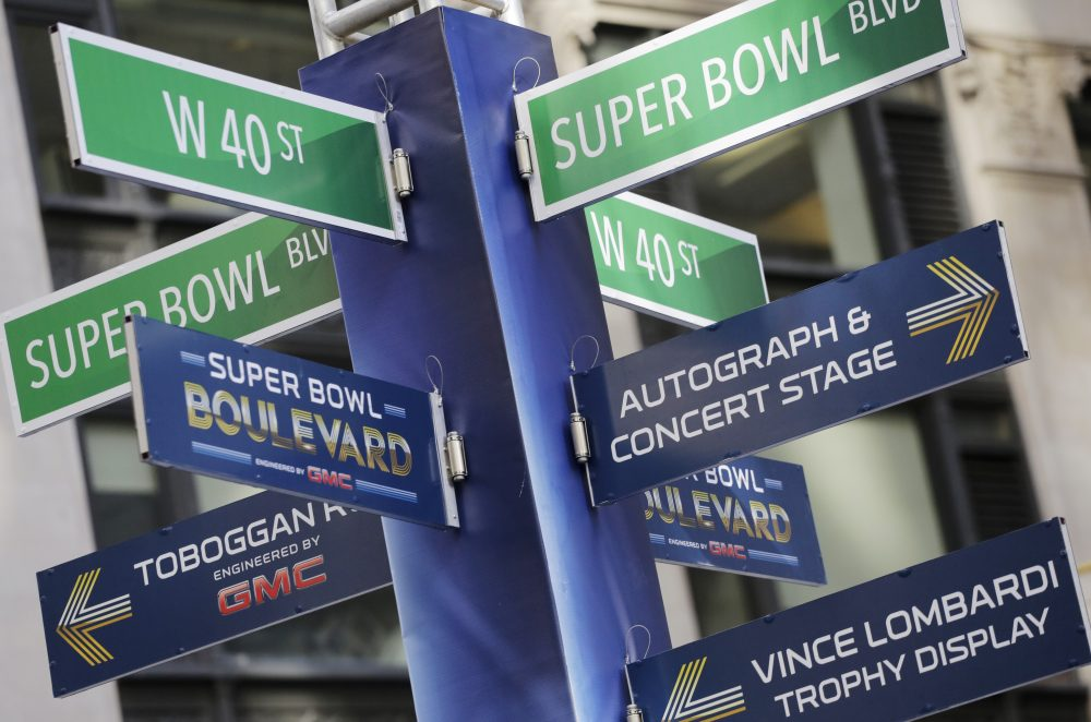 In the U.S., it's hard to avoid crossing paths with the NFL. (Mark Lennihan/AP)