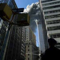 A view of the burning World Trade Center towers from Park Place Street and West Broadway Avenue during the terrorist attacks on Sept. 11, 2001. (Jose Jimenez/Primera Hora via Getty Images)