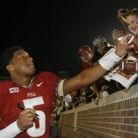 In this Saturday, Nov. 23, 2013 file photo, then-Florida State quarterback Jameis Winston signs autographs after an NCAA college football game against Idaho, in Tallahassee, Fla. After an FSU student accused Winston of rape in 2012, the police did not interview him or obtain his DNA. (Phil Sears/AP)