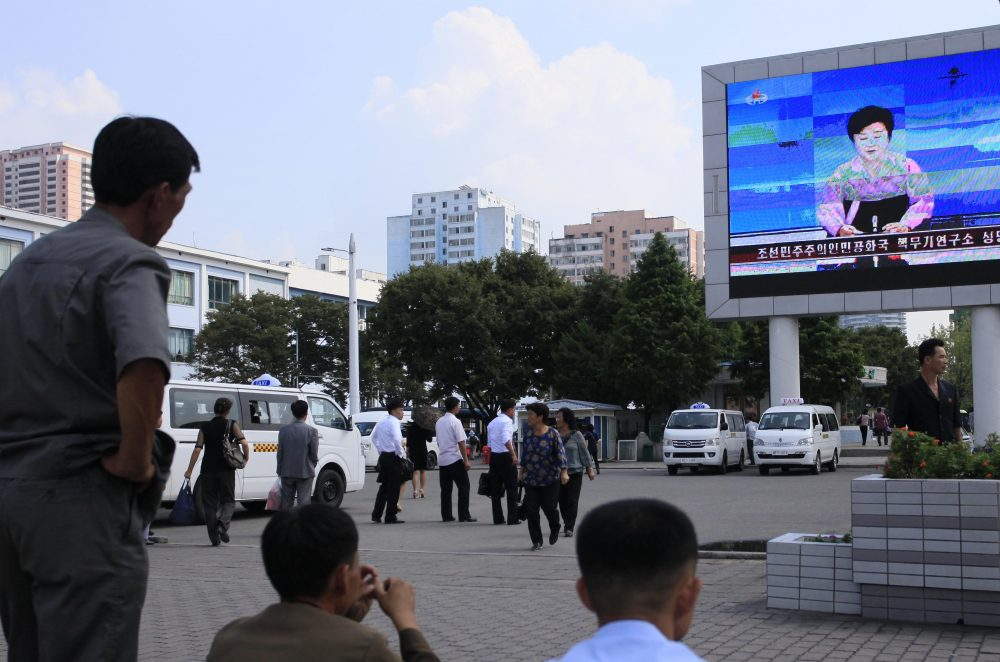 North Koreans watch a news report regarding a nuclear test on a large screen outside the Pyongyang Station in Pyongyang, North Korea, Friday, Sept. 9, 2016. (Jon Chol Jin/AP)