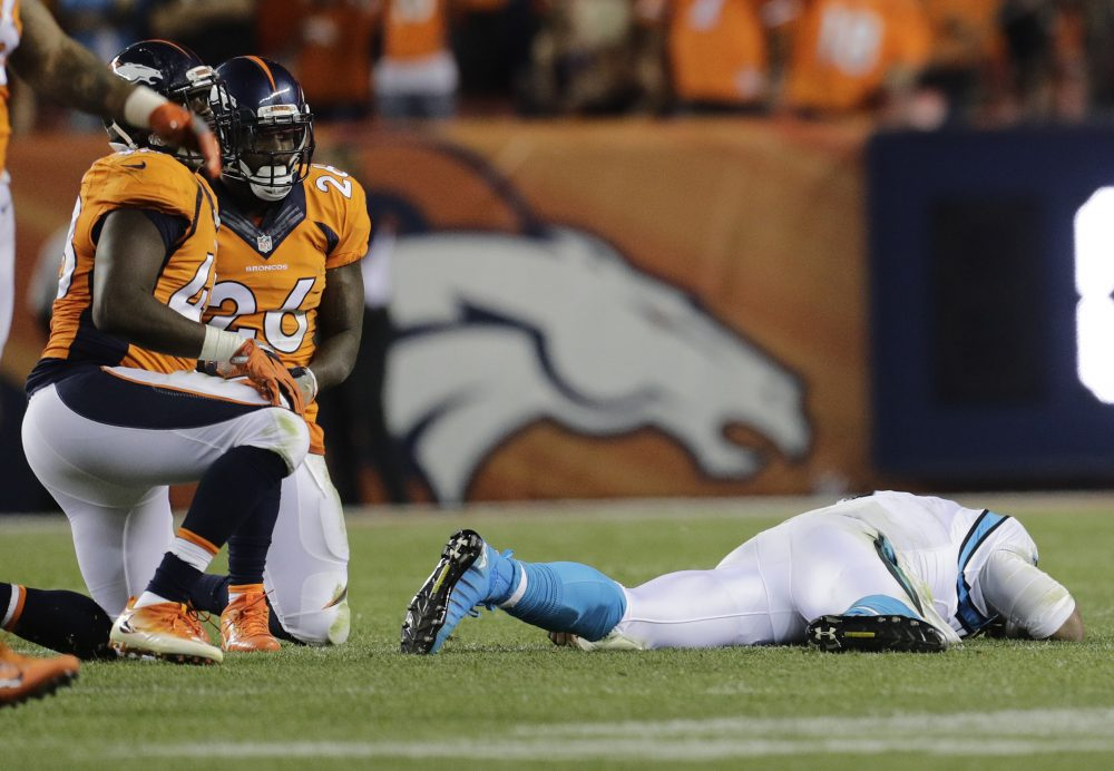 Cam Newton lies on the turf after a roughing the passer penalty on Denver Broncos free safety Darian Stewart. (AP/Joe Mahoney)