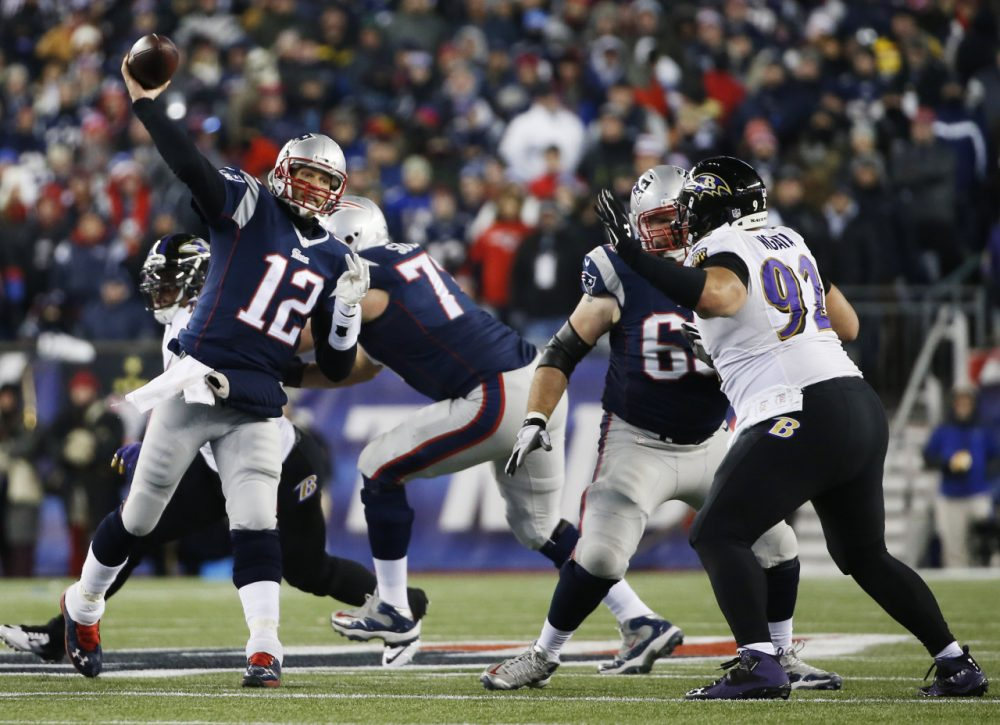 Patriots quarterback Tom Brady passes over Baltimore Ravens defensive end Haloti Ngata (92) in the second half of an NFL divisional playoff football game Jan. 10, 2015, in Foxborough. (Elise Amendola/AP)