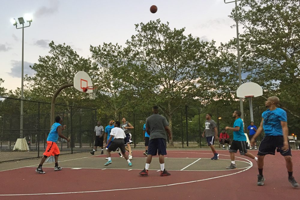 Young men gather to play basketball at the community center of the Hailey Apartments. (Delores Handy/WBUR)