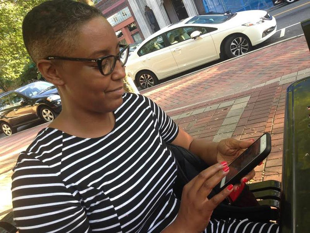 Cicely Mitchell, of Durham, recently opened an account at black-owned Mechanics and Farmers Bank in Durham. On Facebook, she challenged her friends to do the same. (Leoneda Inge/WUNC)