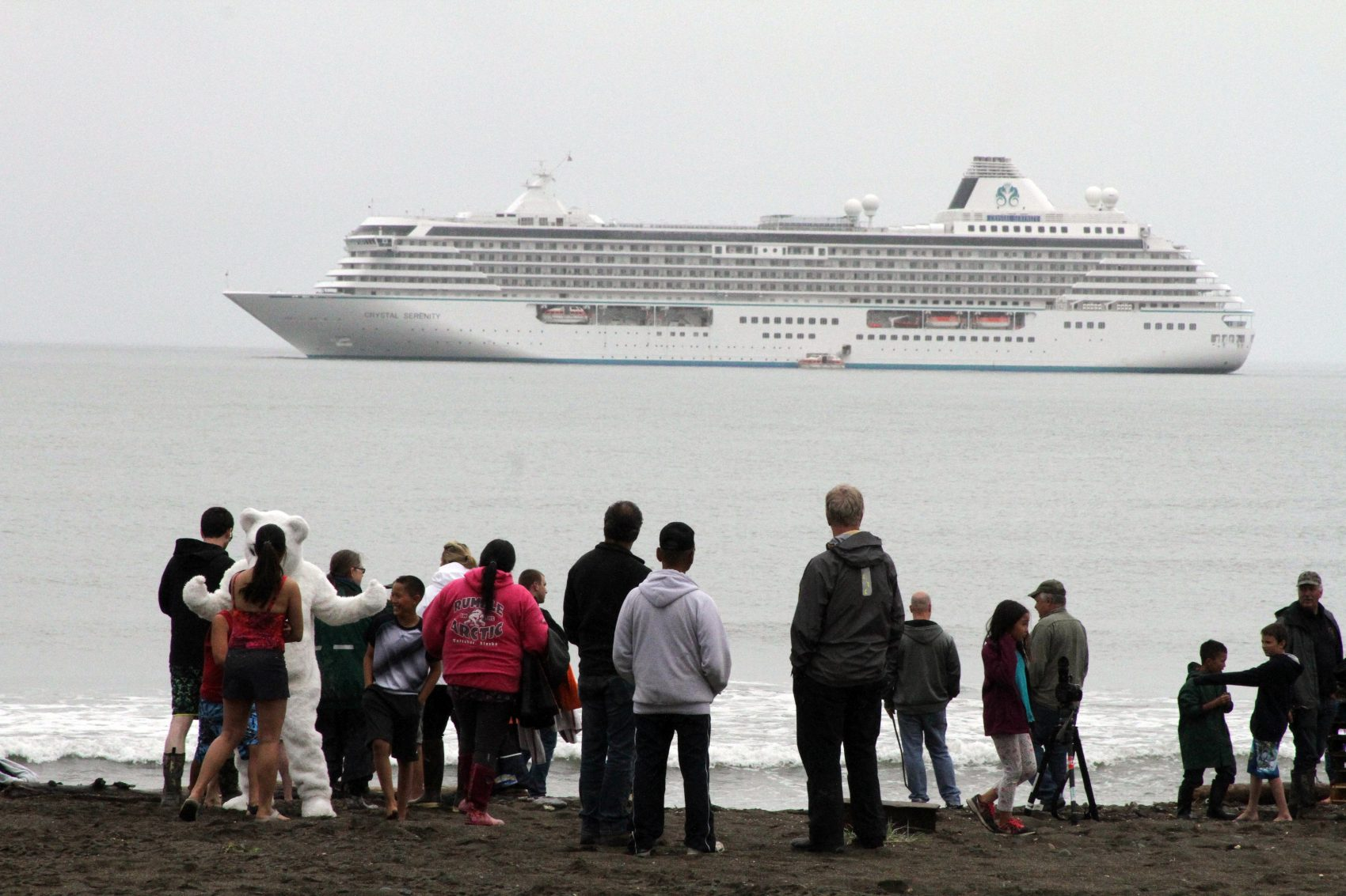 Onlookers prepare to take a polar plunge in the Bering Sea in front of the luxury cruise ship Crystal Serenity, which anchored just outside Nome, Alaska. The ship made a port call as it became the largest cruise ship to ever go through the Northwest Passage, en route to New York City. (Mark Thiessen/AP)