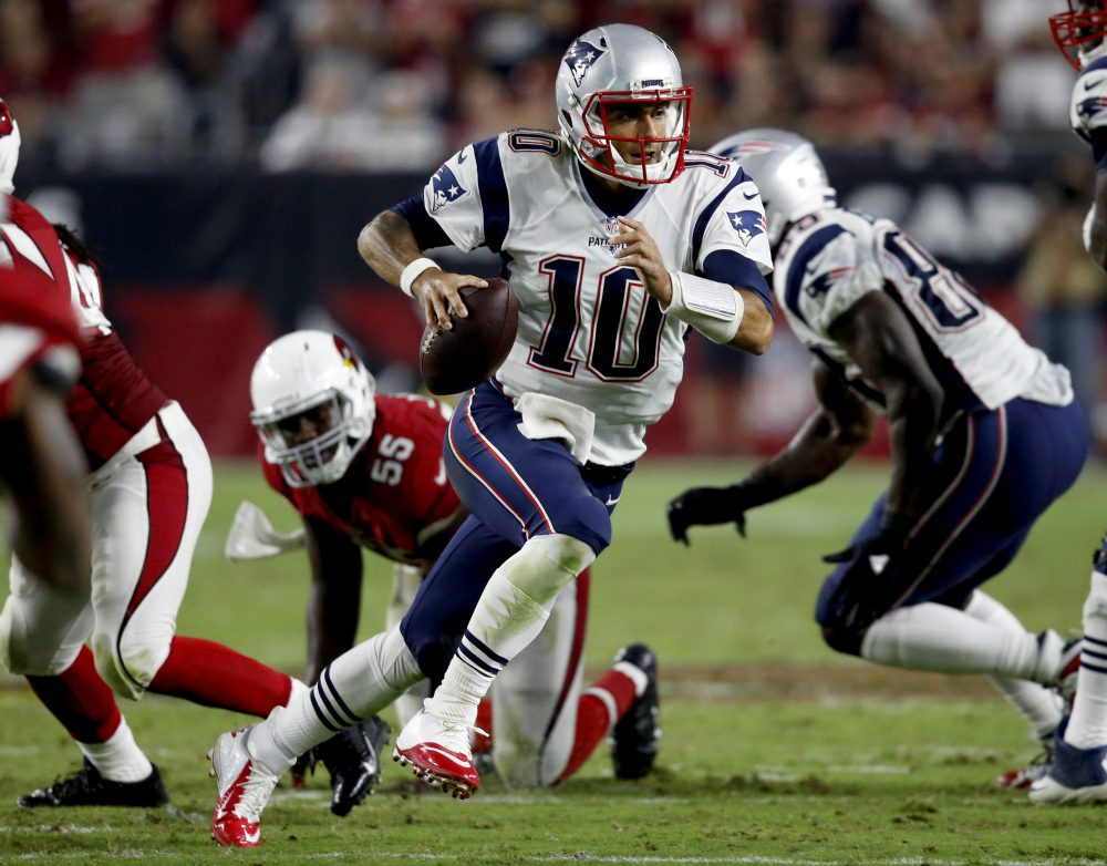 New England Patriots quarterback Jimmy Garoppolo (10) scrambles against the Arizona Cardinals during the second half of an NFL football game on Sunday in Glendale, Ariz. (Ross D. Franklin/AP)