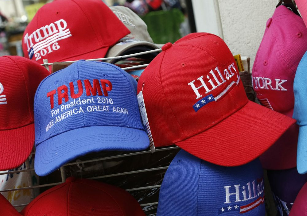 Hats displaying support for Republican presidential candidate Donald Trump and his Democratic opponent Hillary Clinton are displayed by a sidewalk vendor, Tuesday, Aug. 16, 2016, in New York. (Mark Lennihan/AP)