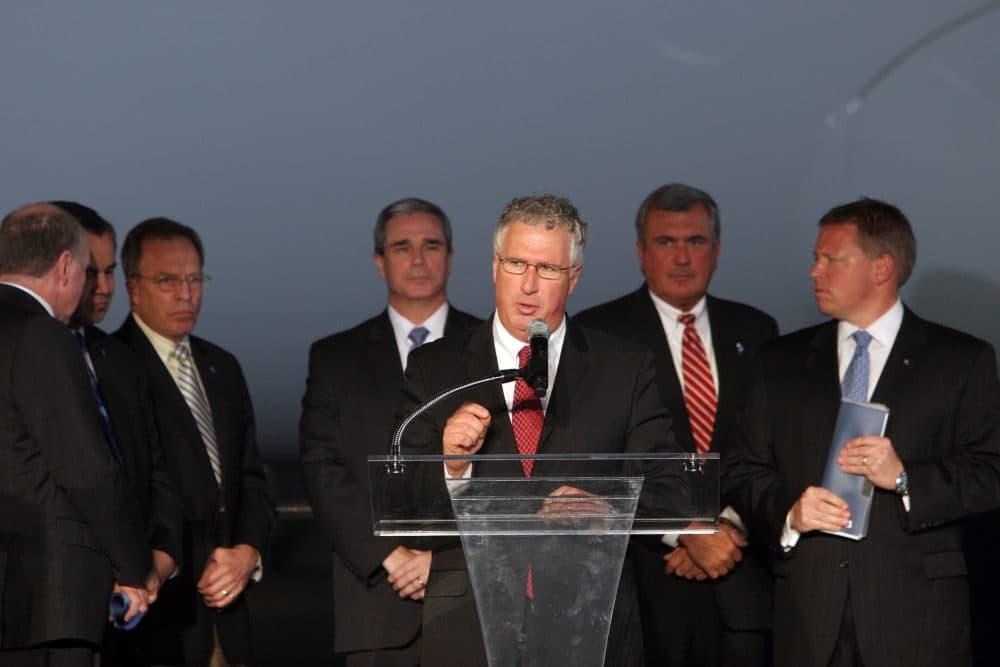 Massachusetts Senator Tom McGee speaks at Logan Airport in Boston in December 2012. (Aynsley Floyd/AP file)