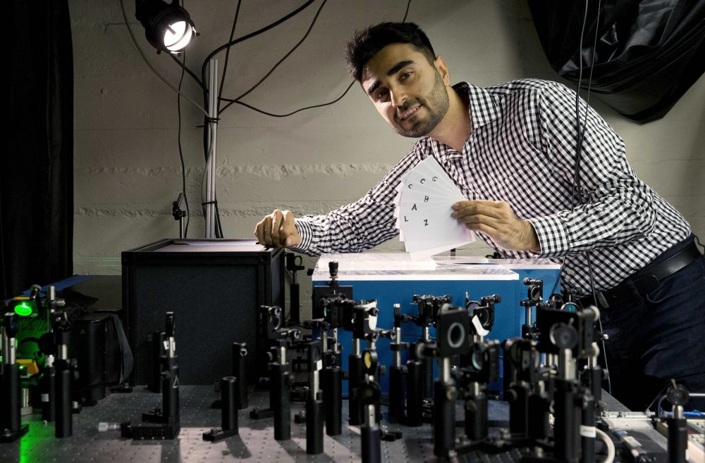 Barmak Heshmat poses with his prototype scanning device in an MIT lab in Cambridge. (Michael Dwyer/AP)
