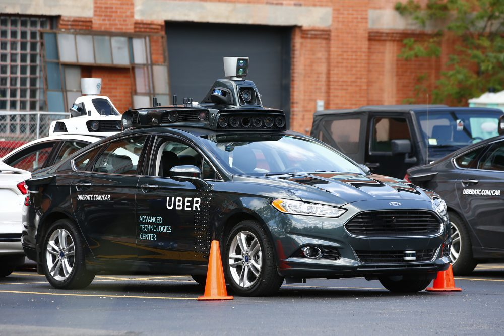 A self-driving Ford Fusion hybrid car sits parked on Aug. 18, 2016 in Pittsburgh. Uber said that passengers in Pittsburgh will be able to summon rides in self-driving cars with the touch of a smartphone button in the next several weeks. (Jared Wickerham/AP)