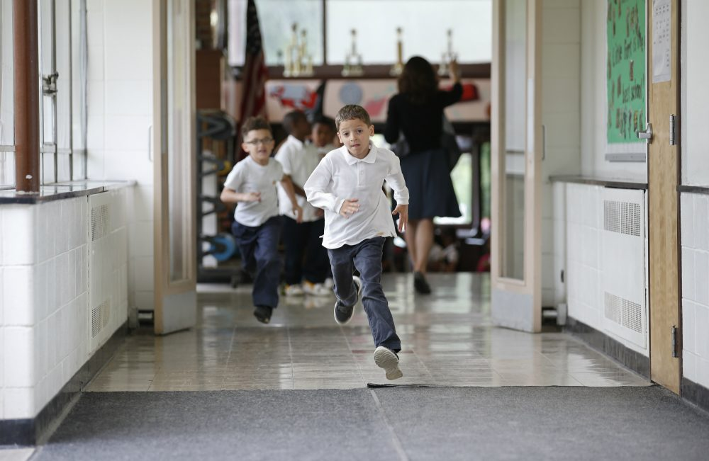 In this Tuesday, June 7, 2016 photo, students run to go outside at the start of a recess between classes at Little Fort Elementary school in Waukegan, Ill. (Kamil Krzaczynski/AP)