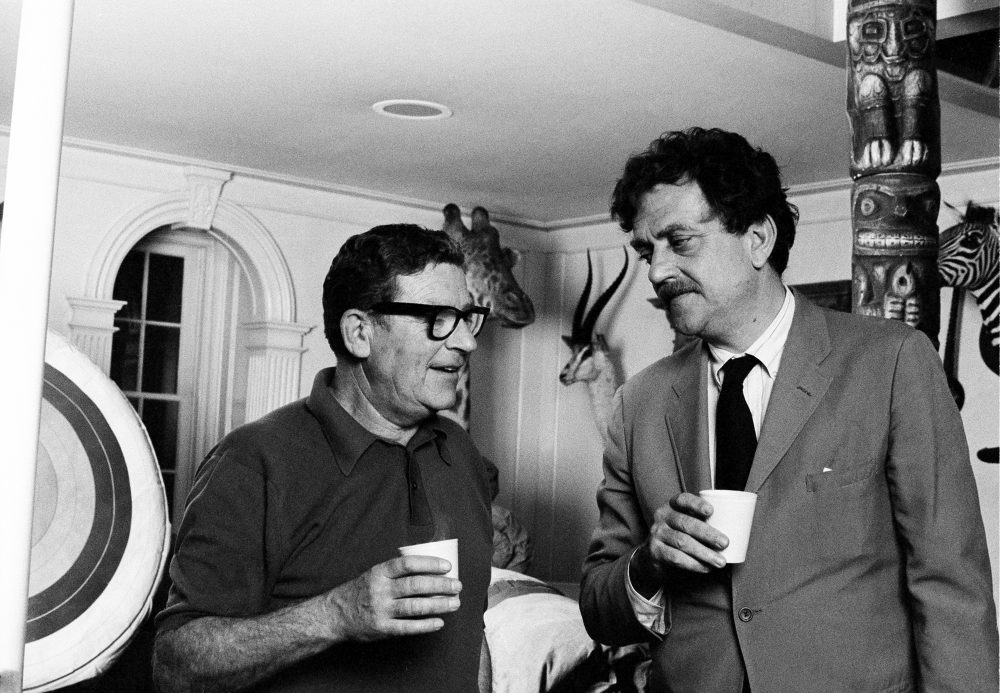 """Kurt Vonnegut, right, talks with producer-director Mark Robson in Hollywood, Calif., on April 27, 1971, during the filming of Vonnegut's first play, """"Happy Birthday, Wanda June."""" (AP)"""